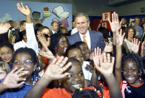 U.S. President George W. Bush greets the students of Justina Elementary School in Jacksonville, Florida, on September 10, 2001, during a Leadership Forum on the importance of reading programs for children. (PAUL J. RICHARDS/AFP/Getty Images)